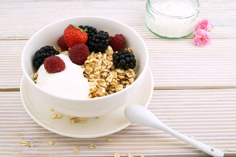 Tips-for-Parents-to-encourage-healthy-eating-for-Kids-greek-yogart-with-raspberries-oats-blackberries-blueberries-suger