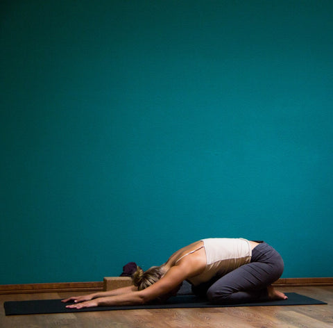 Yoga pose example for lower back pain kids pose