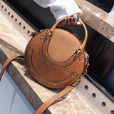 retro circular leather & metal tote hand bag for women