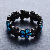 trendy flower design blue fire opal black color ring for women