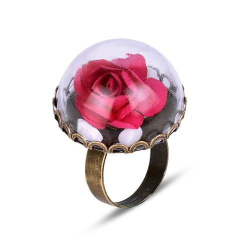 cute flower in a glass dome ring for woman