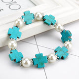 trendy imitation pearl cross carved stone bracelet for women