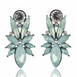 exaggerated crystal stud earrings with opal stone