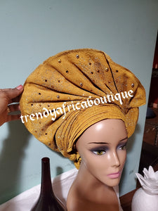Nigerian Auto-gele beaded and stoned. Hassel free, gele wahala is gone, ready for your party in seconds. Aso-oke made auto-gele