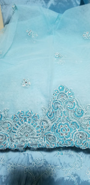 Clearance sale: sky blue Embriodered Taffeta silk George wrapper 5yds  + 1.8yds. Matching net blouse fabric. Small-George Sold as a set. All over embriodery + border hand cut
