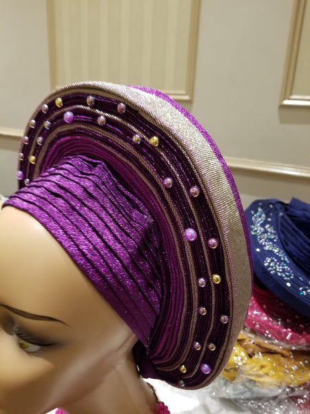 Purple/silver Auto-gele made with quality Aso-oke. Beaded and stoned quality hand work. One size fit, easy to adjust for fit and knot at the back