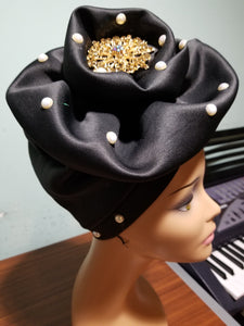 Black color Women-turban. One size fit all turban. Beautiful flower design with a side brooch to add decor to your head wrap accessories. Head wrap made ready