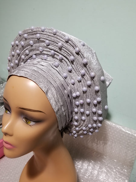 New arrival:  Nigeria auto-gele in Silver. Made with quality aso-oke/woven in Nigeria. made into gele. beaded and stoned. Party ready in less than 5 minutes. One size fit, easy adjustment at the back
