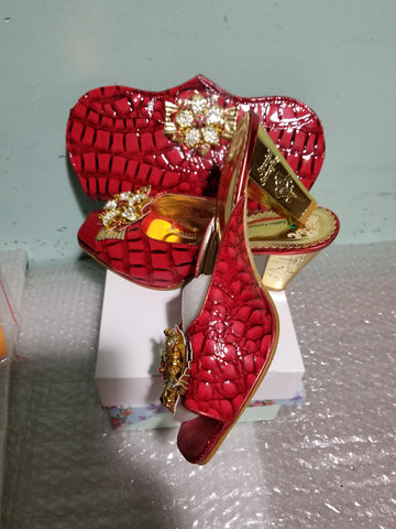 "Sale: Size 39 Red Italian style matching slipper shoe and hand clutch. Quality made shoe and bag. 3"" heel Sold as a set"