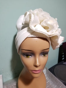 Off white color Women-turban. One size fit all turban. Beautiful rose flower design with a side brooch to add decor to your turban
