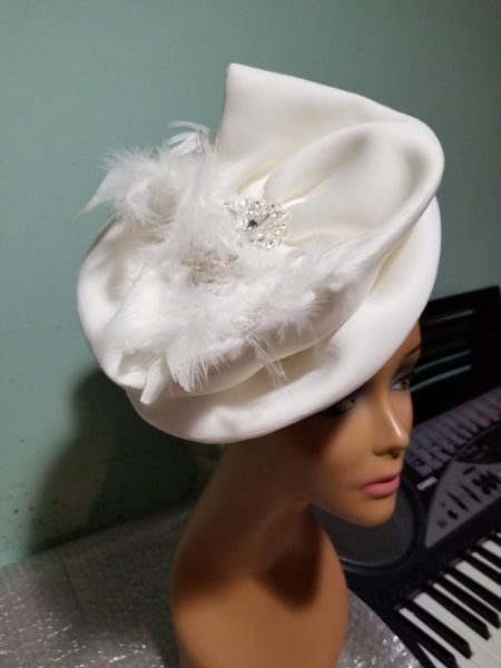 Off White turban design with white feather. Dress it up to chure or party. Women-turban. One size fit all turban. Beautiful design with a side brooch to add decor to your turban