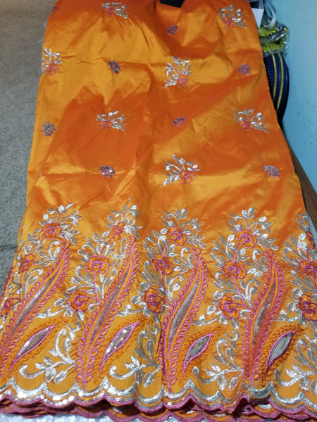 Clearance item: Orange Embriodery silk Geoge fabric. Beautiful flower border. Original quality George for making African party dress. Indian-George sold per 5yards and price is for 5yds