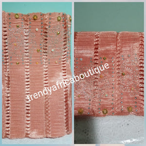 Latest Peach color Aso-oke Gele only. Bead dazzled and stones border. Holes and stones woven from Nigeria. Original quality