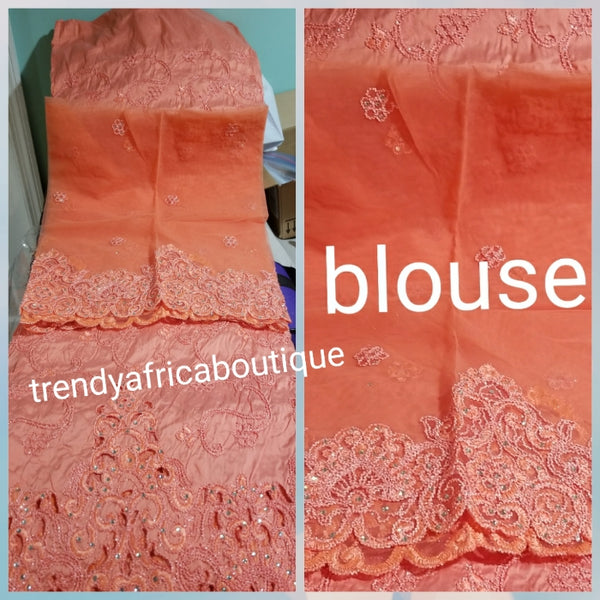 Special sale: small-George Peach Embroidery taffeta silk George wrapper for making Nigerian special Ocassion dresses. Sold 5yrds wrapper + 1.8yds net blouse