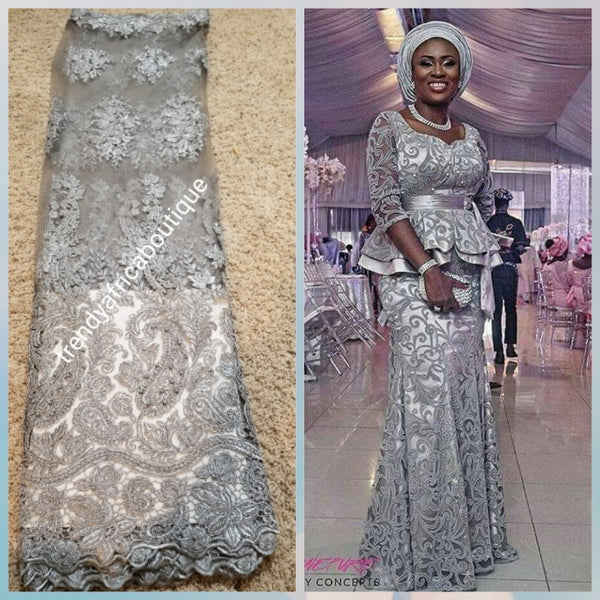 New arrival ash/Gray net French lace. Swiss Quality lace stoned with pearls and crystal. Sold per 5yds. Nigerian french lace fabric. Rich quality for wedding dress
