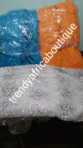 "Assorted colors net beaded and stoned fabric for making Blouses for skirt or wrapper.  sold per-yard  36"" by 50"" wide. Available in royal blue, silver orange and turquoise blue"