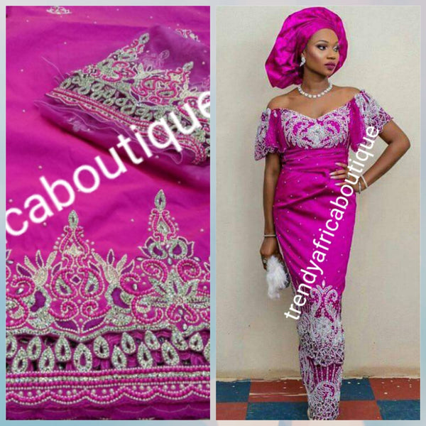 On sale: Heavily Beaded/stoned Igbo traditional  celebrant Silk George wrapper with matching net blouse. Fuchsia pink color