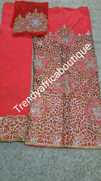 Heavily Beaded/stoned VIP Nigerian/Igbo wedding George wrapper and blouse. Sweet Coral color perfect with gold/white crystals for that special occasion.5yd + 1.8yds matching blouse