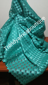 Sizzling Teal green  French lace fabric. Embellished with all over stones. Sold 5 yards length