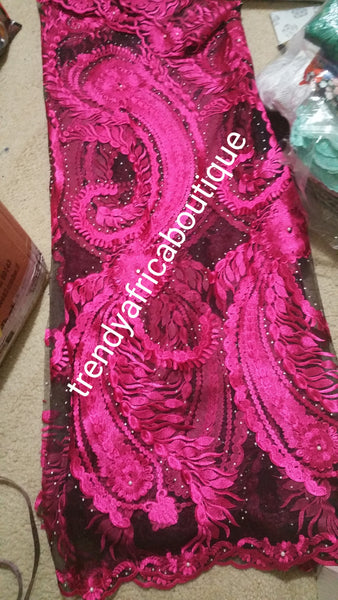 Black/fuchsia net french lace fabric with all over stones. Great quality. Sold per 5yrds. Model shown wearing Purple color