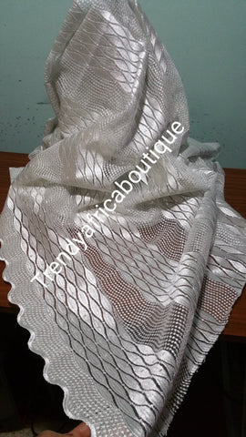 White/white swiss french lace fabric. Soft texture, great quality. Sold per 5 yards