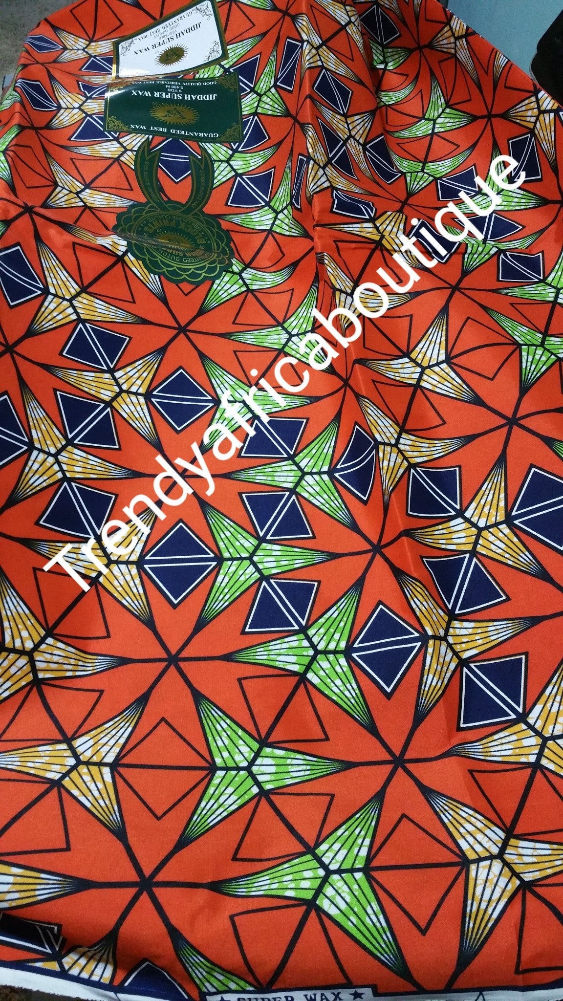 Veritable African Cotton wax print fabric. 100% cotton. Orange color. 6yrds per each length