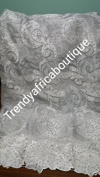 CLEARANCE ITEM: white French lace fabric with silver lurex and all over crystal stone work. Sold 5yards length