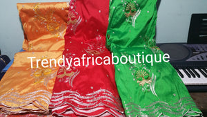 Embroidery Indian Silk George wrapper. Sold 5 yards lenght.embroidery and stones design for African party dress. Available in Green, red and Orangel. Small-George