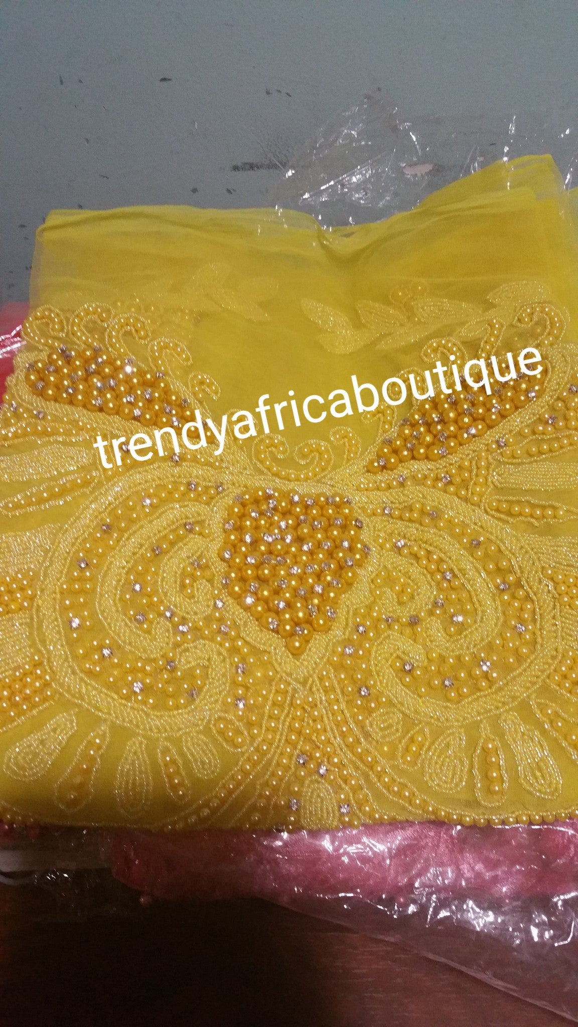 Assoted colors of heavily-beaded net for  making NIgerian women blouses. 1.8yds net and fully beaded for making blouse for party wrappers. 3 colors available in this design