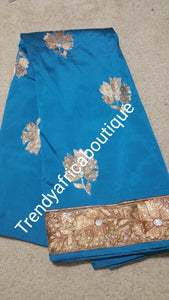 Sale: Turquoise blue/Gold silk George wrapper. Original quality African George sold as 5yrds lenght.