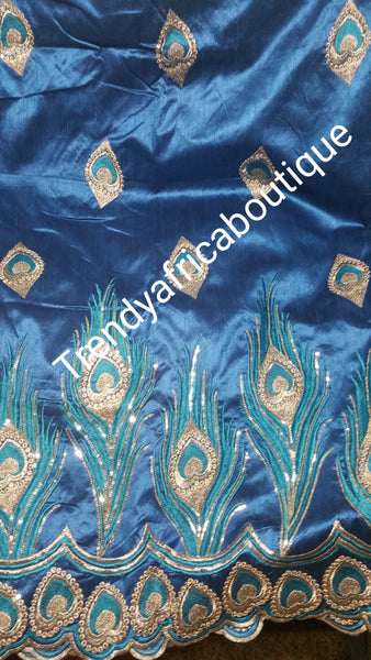 Turquoise blue/gold Embroidery Indian fancy silk George wrapper. Sold as 5yrds lenght. Price is for 5yds. Original silk quality. Small-George