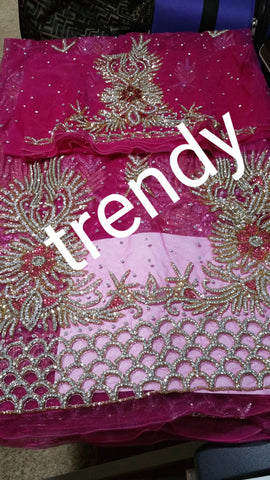 Fuschia pink Madam hand stoned Net George wrapper and matching blouse. Nigerian high society ceremony as wedding. Sold as set 6.5yds total