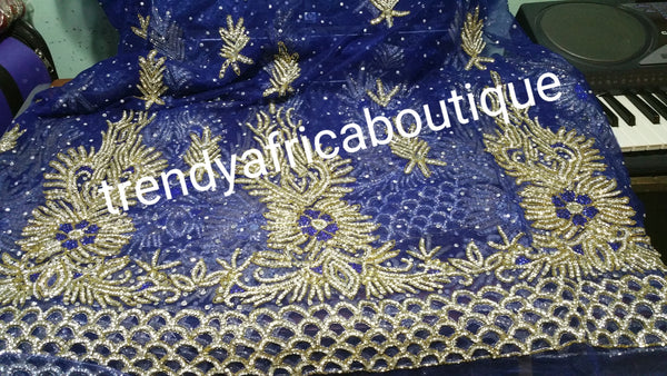 Royal blue VIP Net George wrapper. All over dazzling crystal stones design, handcut border. Very rich and classic. 5yds+ 1.8yds matching for blouseblouse.