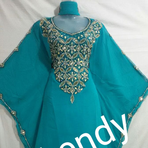Turqouse blue African Bubu kaftan dress. Full chest Dazzling Crystal Stones and sleeve line. Free flowing rob.