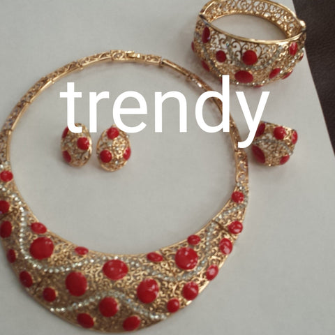4pc omega necklace set.  18K gold plating with Red beads accent. Hypoallergenic quality