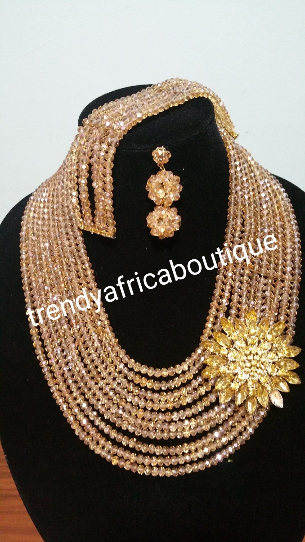 Gold Crystal beaded necklace set with a side broach. Multi layer beaded-necklace with Bracelet earrings. Also sell Coral-necklace