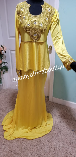 "Yellow Kaftan dress. Free flowing I can Kaftan made with Lycra materia and beaded with gold beads. Soft texture, long 60"" dress"
