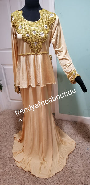 Indian Kaftan dress made with Lycra/spandex fabric. Long free flowing dress champagne gold color wit Gold beads.