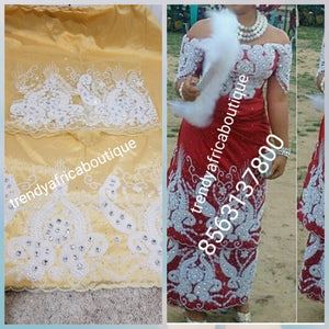 Light Gold Nigerian Traditional wedding George wrapper for special occasion. quality Silk George and matching net blouse beaded and hand stoned  work to perfection. Sold per set of 5yds wrapper and 1.8yrds blouse fabric