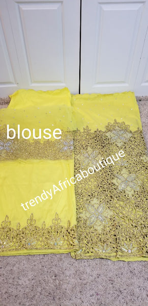 Yellow VIP crystal hand stoned celebrant George wrapper for Nigerian Ceremonies such as weddings. Igbo/Niger Delta wedding George. Sold as a set of wrapper and matching net blouse