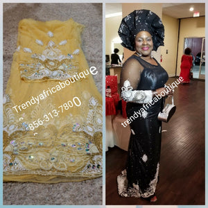 Heavily Beaded and hand stoned Net George fabric for Nigerian Ceremonies. Beautiful Gold color. Come 6.5yds fabric.