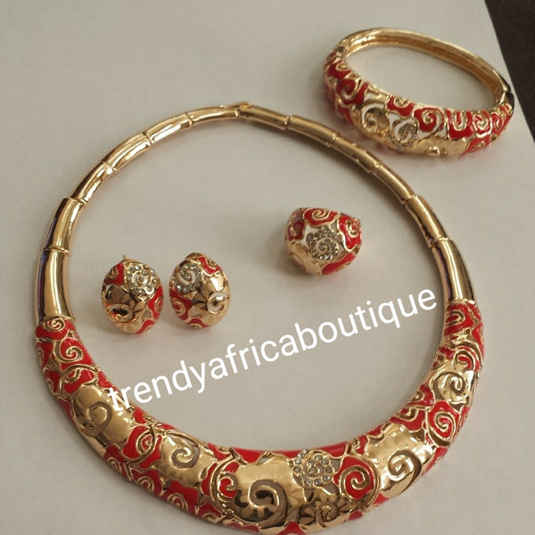 4pc. 18k Gold plated Omega necklace set. Include matching earrings, Bangle and ring. Gold/ red design for African party use