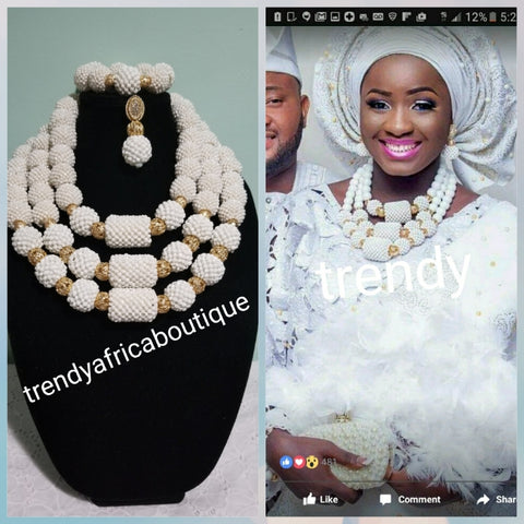 Bold and Beautiful 3 role coral Beaded-necklace set in white. Sold with bracelet and earrings. Use for big Africa/Nigerian ceremony. White color