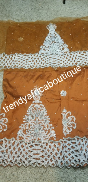 New arrival Burnt Orange Gorgeous Igbo/Delta silk George wrapper and matching net blouse. 5yds + 1.8yds matching net for blouse. Sold as a set, price is for a set