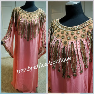 Coral pink long free flowimg Kaftan dress. Hand beaded and stoned. Free size to fit up to 2XL. Classic Dubai Kaftan dress for women