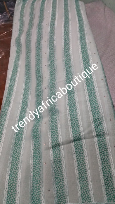 On Sale: quality men swiss Voile lace fabric for making Nigerian native cloting for men. Soft texture. Sold per 5yds. In white/Green