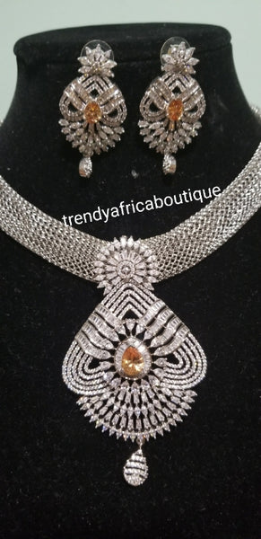 2pcs set 22k electroplated Dubai Gold. Sold as necklace and matching earrings.  Silver set with gold CZ stones