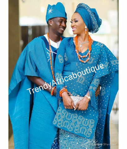 Celebrant Agbada Beaddazzled Aso-oke in turqouise blue. Custom-made design. Make-to-order only. Aso-oke set for man and woman. Can be order for individual only or complet set for couple. 6-8 weeks for production. Nigerian Traditional wedding outfit