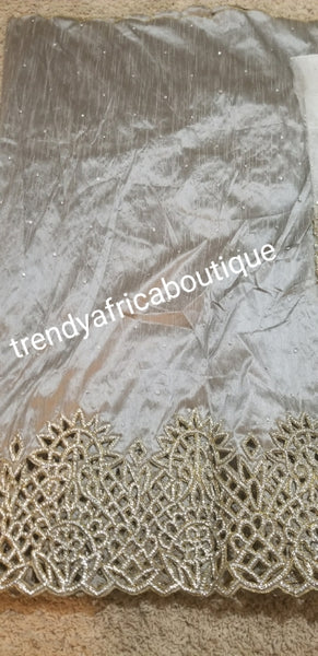 Clearance: Gray  VIP handcut border  George wrapper with crystal stones. Delta/Igbo women George wrapper with matching white net for blouse. Quality cut and stoned work. On clearance. 5yards George wrapper and 1.8yds white contract blouse