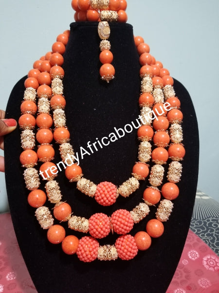New arrival Edo round coral-necklace set. Traditional Bridal wedding Coral beads  long row in 3 pce. earrings and double Bracelets. Exclusive Nigerian Native bead design with gold accessories sold per set. Bridal-accessories